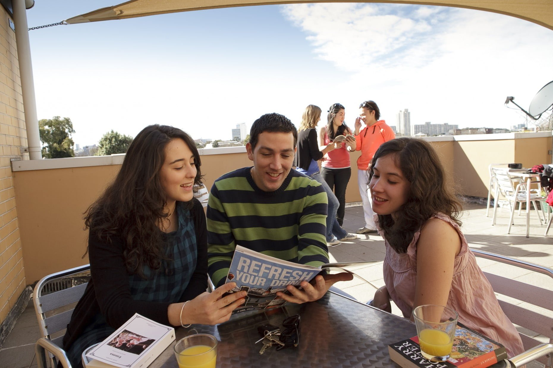 Students relax on the terrace of the College