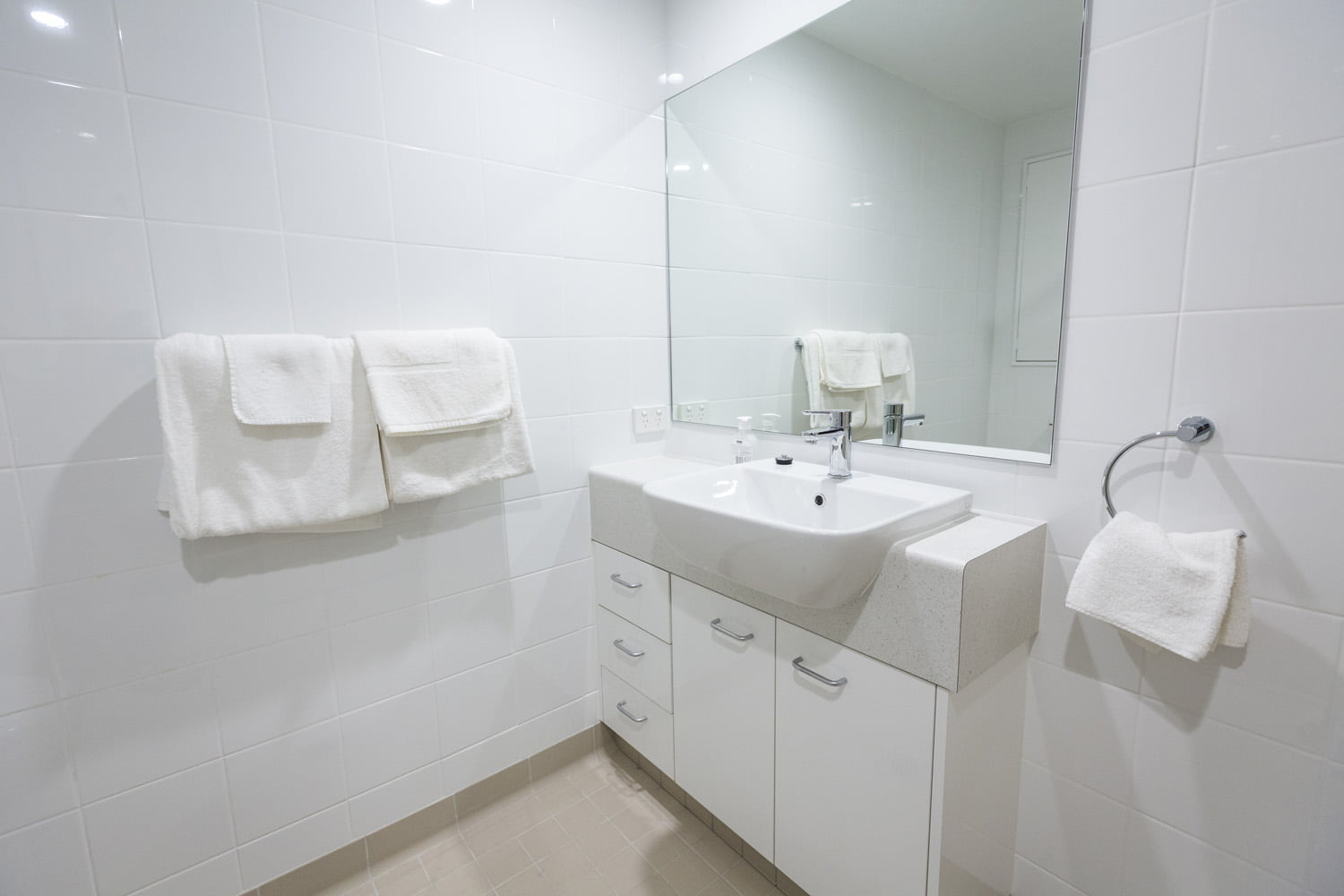 The studio room features a private bathroom
